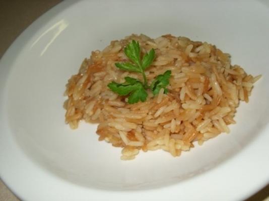 arroz condimentado com vapor com cominho e suco de limão